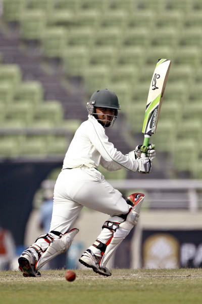 Bangladesh's Mominul Haque plays a shot against Sri Lanka on the fourth day of their first test cricket match in Dhaka, Bangladesh, Thursday, Jan. 30, 2014. (AP Photo/A.M. Ahad)