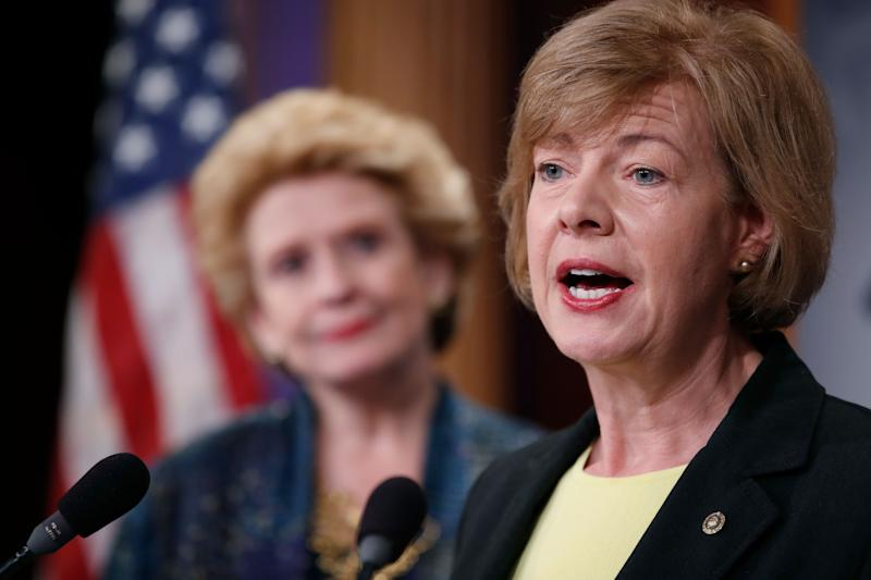 Sen. Tammy Baldwin, D-Wis., right, accompanied by Sen. Debbie Stabenow, D-Mich., speaks on Capitol Hill in Washington, Tuesday, April 25, 2017, during a news conference to discuss President Donald Trump's first 100 days,. (AP Photo/Alex Brandon)