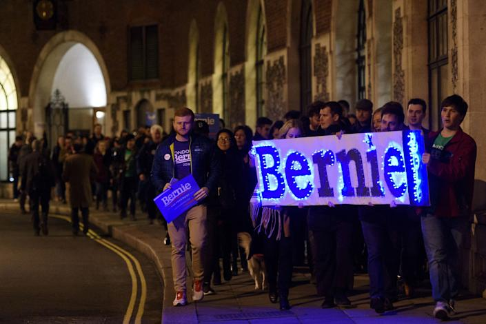 LONDON, ENGLAND - MARCH 01: Supporters of American Democrat candidate Bernie Sanders carry a sign with the slogan 'Bernie 2016' as they march to a local polling station during a Super Tuesday rally in Parliament Square on March 1, 2016 in London, England. Super Tuesday is a day in the United States presidential primary season where a large number of states hold their primary elections. American citizens abroad are allowed to vote for their chosen candidate at local polling centres. (Photo by Ben Pruchnie/Getty Images)