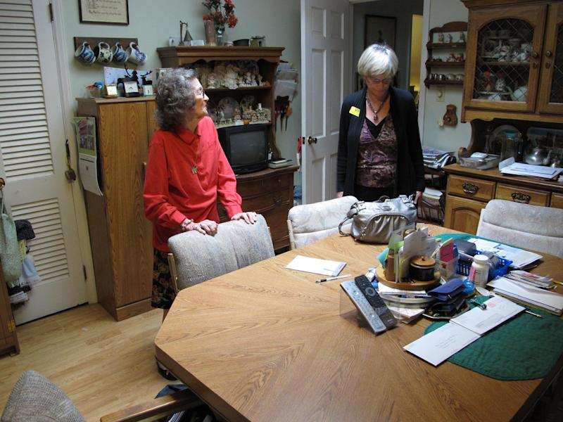 In this Thursday, April 19, 2012 photo, Miriam Parker, left, talks with her daughter Donna at the table in the kitchen of the Raleigh, N.C., home where she and her husband raised their four children. The 87-year-old woman lost her life's savings and went deeply into debt because of a Canadian sweepstakes scam. (AP Photo/Allen Breed)