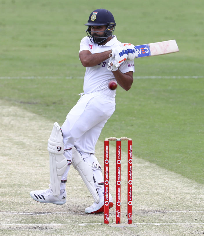 India's Rohit Sharma bats during play on day two of the fourth cricket test between India and Australia at the Gabba, Brisbane, Australia, Saturday, Jan. 16, 2021. (AP Photo/Tertius Pickard)