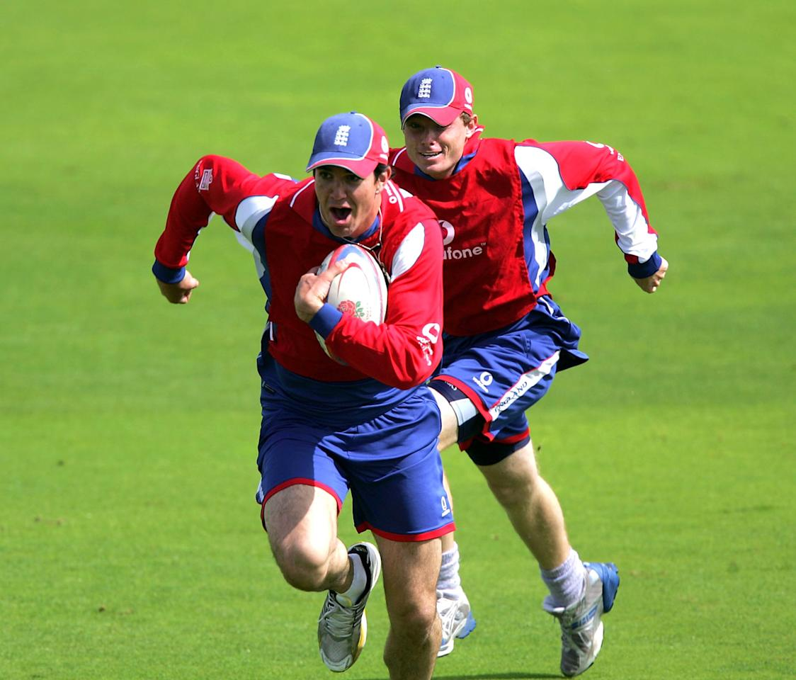Kevin Petersen and Ian Bell of England run with a rugby ball during the England nets session prior to the 4th Ashes npower Test Match at Trent Bridge on August 23, 2005 in Nottingham, England. (Photo by Matthew Lewis/Getty Images) *** Local Caption *** Kevin Petersen; Ian Bell