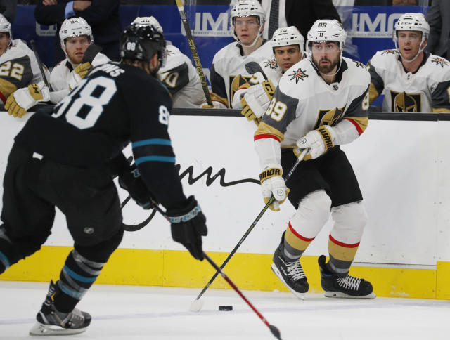 Vegas Golden Knights right wing Alex Tuch (89) passes the puck as San Jose Sharks defenseman Brent Burns defends during the second period of an NHL hockey game Thursday, Jan. 10, 2019, in Las Vegas. (AP Photo/John Locher)