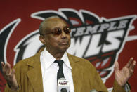 FILE - Temple basketball coach John Chaney gestures while speaking about his retirement at a news conference in Philadelphia, in this Monday, March 13, 2006, file photo. John Chaney, one of the nation's leading Black coaches and a commanding figure during a Hall of Fame basketball career at Temple, has died. He was 89. His death was announced by the university Friday, Jan. 29, 2021. (AP Photo/Joseph Kaczmarek, File)