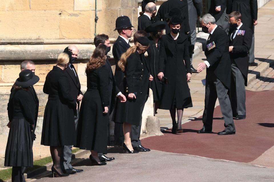 Catherine, Duchess of Cambridge (right) and other members of the extended royal family wait to enter St. George's Chapel for the funeral service.