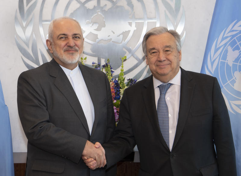 In this photo provided by the United Nations, U.N. Secretary General Antonio Guterres, right, greets Mohammad Javad Zarif, Minister for Foreign Affairs, Islamic Republic of Iran, Wednesday, April 24, 2019 at United Nations headquarters. (Eskinder Debebe/The United Nations via AP)
