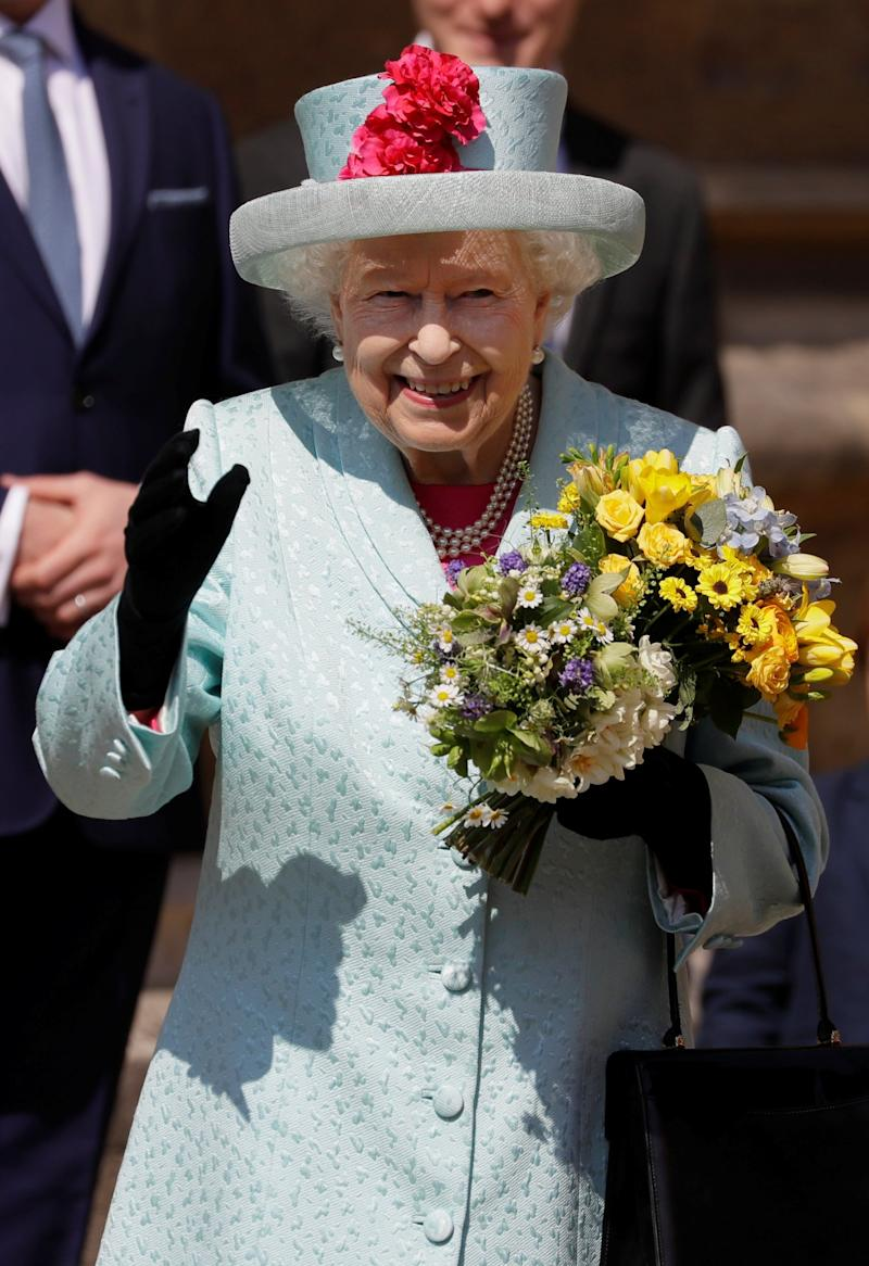Queen Elizabeth II waves as she leaves the Easter Mattins Service at St George's Chapel (REUTERS)