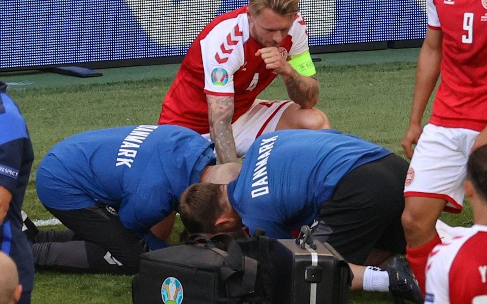 Simon Kjaer watches over team-mate Christian Eriksen - Christian Eriksen collapse: Simon Kjaer and his team-mates' protective shield was team spirit at its most stirring - GETTY IMAGES