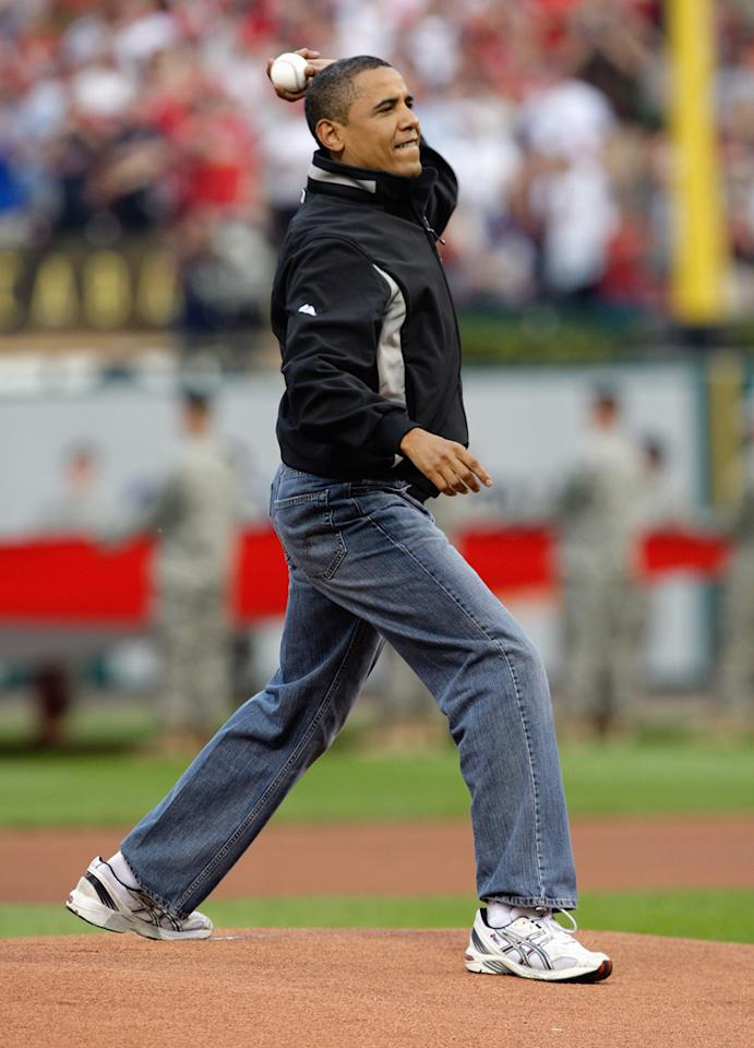 President Barack Obama throws the first pitch before the 2009 MLB All-Star Game at Busch Stadium on July 14, 2009 in St Louis, Missouri. (Photo by Jamie Squire/Getty Images)
