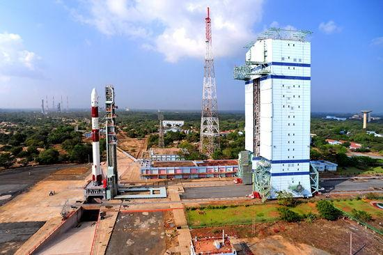 This panoramic view shows India's PSLV-C20 rocket on the First Launch Pad with the Mobile Service Tower at a distance. The rocket will launch seven satellites into orbit on Feb. 25, 2013, from the Satish Dhawan Space Centre in Sriharikota, Indi