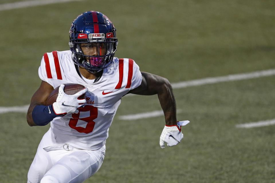 FILE - Mississippi wide receiver Elijah Moore (8) runs for yardage during an NCAA college football game against Vanderbilt in Nashville, Tenn., in this Saturday, Oct. 31, 2020, file photo. Moore is a possible first round pick in the NFL Draft, April 29-May 1, 2021, in Cleveland. (AP Photo/Wade Payne, File)