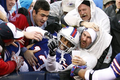 Buffalo Bills wide receiver Stevie Johnson (13) celebrates a touchdown catch with fans during the second half of an NFL football game against the Jacksonville Jaguars, Sunday, Dec. 2, 2012, in Orchard Park, N.Y. (AP Photo/Bill Wippert)