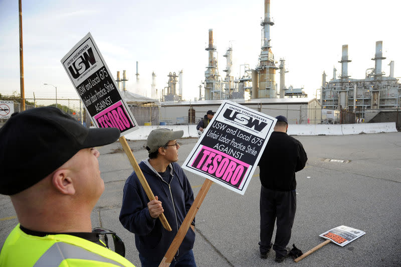 Members of the United Steel Workers union picket the Tesoro refinery in Carson, California