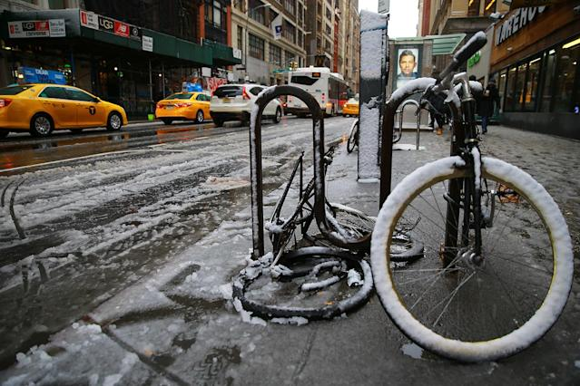 <p>Slushy snow covers streets and bikes in New York City on March 7, 2018. (Photo: Gordon Donovan/Yahoo News) </p>