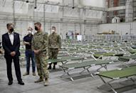 US Secretary of State Antony Blinken tours a processing centre for Afghan refugees at al-Udeid Air Base in the Qatari capital Doha (AFP/Olivier DOULIERY)