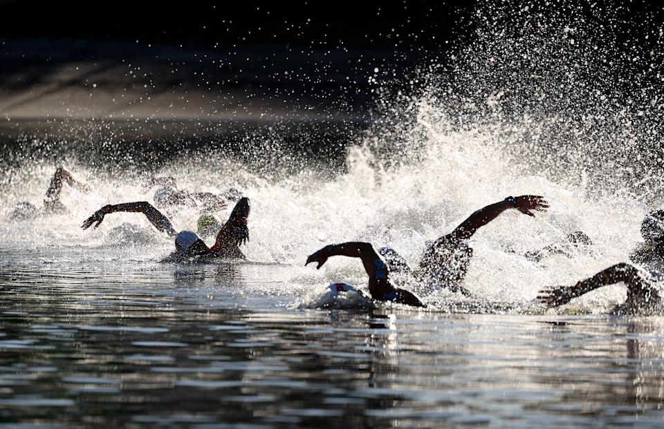 <p>Swimmers start the race in the Men's 10km Marathon Swimming on day thirteen of the Tokyo 2020 Olympic Games at Odaiba Marine Park on August 05, 2021 in Tokyo, Japan. (Photo by Al Bello/Getty Images)</p>