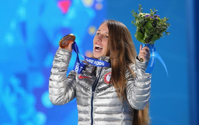 SOCHI, RUSSIA - FEBRUARY 21: Gold medalist Maddie Bowman of the United States celebrates during the medal ceremony for the Women's Ski Halfpipe on day fourteen of the Sochi 2014 Winter Olympics at Medals Plaza on February 21, 2014 in Sochi, Russia. (Photo by Quinn Rooney/Getty Images)