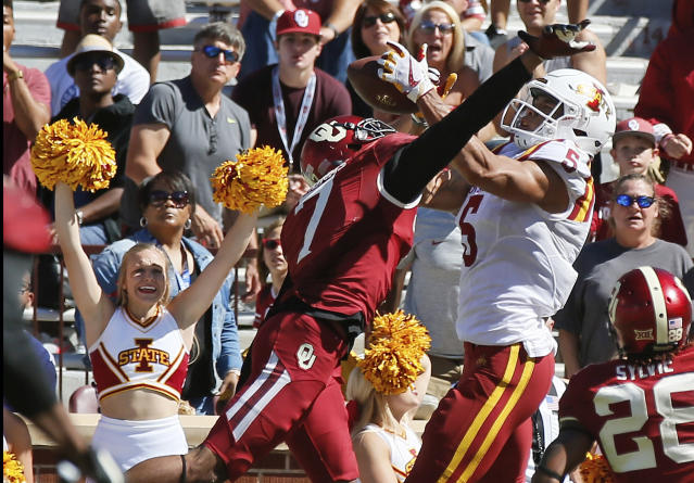 "Iowa State wide receiver <a class=""link rapid-noclick-resp"" href=""/ncaaf/players/244237/"" data-ylk=""slk:Allen Lazard"">Allen Lazard</a> (5) catches the game winning touchdown between Oklahoma cornerback Jordan Thomas (7) and safety Chanse Sylvie (28) in the fourth quarter of an NCAA college football game in Norman, Okla., Saturday, Oct. 7, 2017. Iowa State won 38-31. (AP Photo/Sue Ogrocki)"