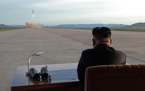 <span>North Korean leader Kim Jong-un inspects a launching drill of the medium-and-long range strategic ballistic rocket Hwasong-12 at an undisclosed location in September</span> <span>Credit: AFP </span>