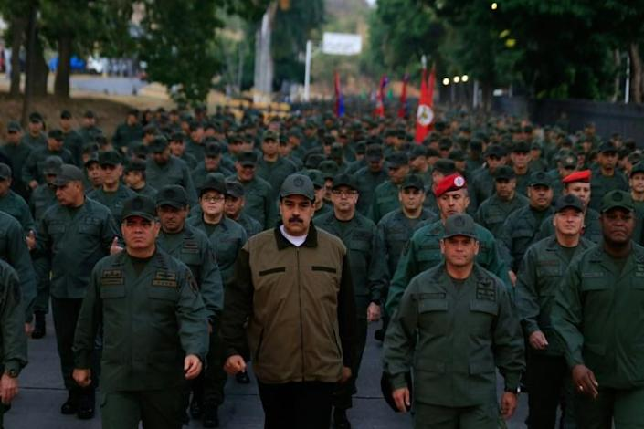 This Venezuelan government handout picture shows President Nicolas Maduro (C) marching with soldiers and his top military brass on May 2, 2019 in Caracas (AFP Photo/HO)
