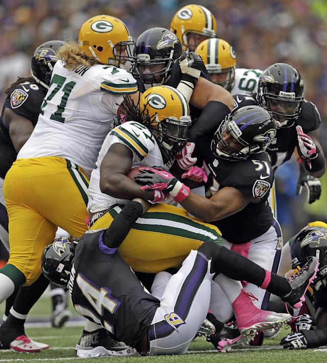 Green Bay Packers running back Eddie Lacy (27) is brought to a sudden stop during the first half of a NFL football game against the Baltimore Ravens in Baltimore, Sunday, Oct. 13, 2013. (AP Photo/Patrick Semansky)