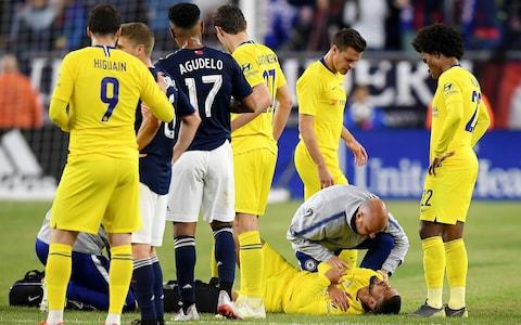 <span>Loftus-Cheek was later seen leaving on crutches</span> <span>Credit: Getty Images </span>