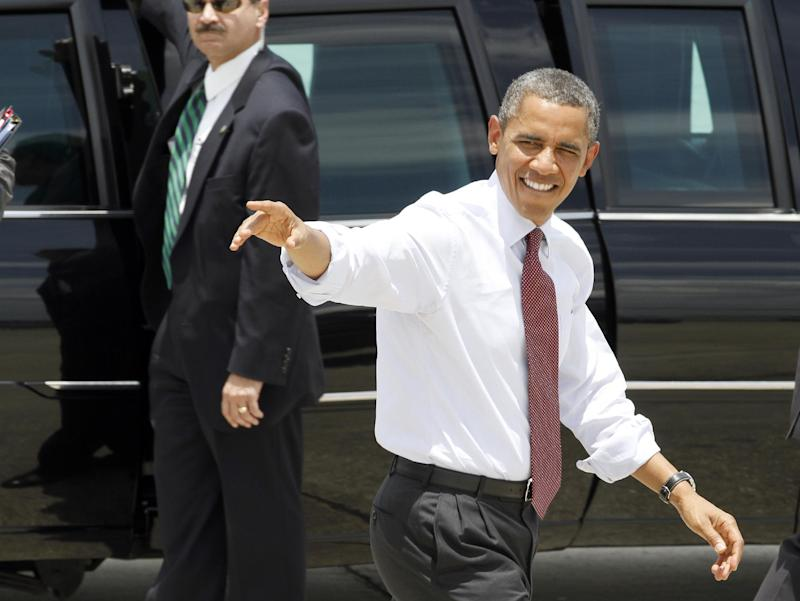 President Barack Obama waves upon his arrival in Orlando, Fla., Thursday, Aug. 2, 2012,  (AP Photo/Reinhold Matay)
