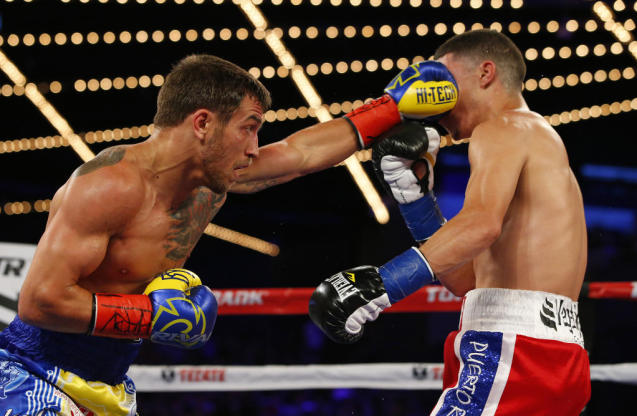 According to his promoters from Top Rank, Vasyl Lomachenko (L) has the kind of speed, skill and power that make top fighters in the super featherweight ranks reluctant to face him (AFP Photo/Rich Schultz)