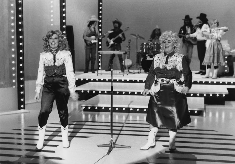 Comic actors Jennifer Saunders (left) and Dawn French dressed as county music singers in a sketch from the television comedy show 'French and Saunders', February 14th 1988. (Photo by Don Smith/Radio Times/Getty Images)
