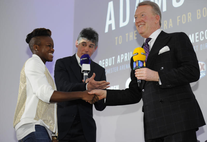 Nicola Adams, left, shakes hands with boxing promoter, Frank Warren, during a press announcement in central London, Monday Jan. 23, 2017. Two-time Olympic women's boxing champion Nicola Adams has turned professional. The 34-year-old flyweight from Britain has joined promoter Frank Warren and will make her professional debut in Manchester on April 8. (Charlotte Ball/PA via AP)