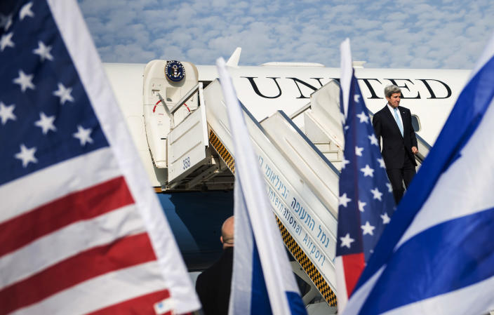 U.S. Secretary of State John Kerry steps off the plane upon his arrival at Ben Gurion airport near Tel Aviv, Israel, Thursday, Jan. 2, 2014. Kerry arrived Thursday in Israel to broker Mideast peace talks that are entering a difficult phase aimed at reaching a two-state solution between the Israelis and Palestinians. (AP Photo/Brendan Smialowski, Pool)