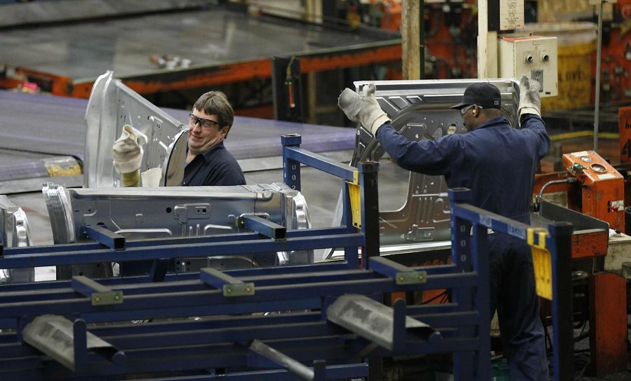 In this April 4, 2012 photo, auto workers at the Ford Stamping Plant stack the inner door panel for the Ford Explorer, in Chicago Heights, Ill. The Labor Department says the economy added 120,000 jobs in March, down from more than 200,000 in each of the previous three months. Manufacturers added 37,000 jobs. (AP Photo/Charles Rex Arbogast)
