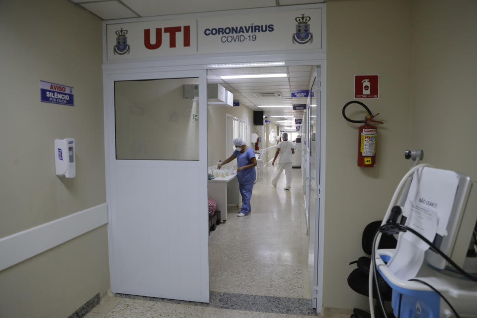 Health personnel work at the intensive care unit at the Santa Casa Hospital in Jau, Brazil, Thursday, Jan. 28, 2021. The hospital is operating at full capacity due to COVID-19 and patients need to take turns receiving oxygen. (AP Photo/Andre Penner)