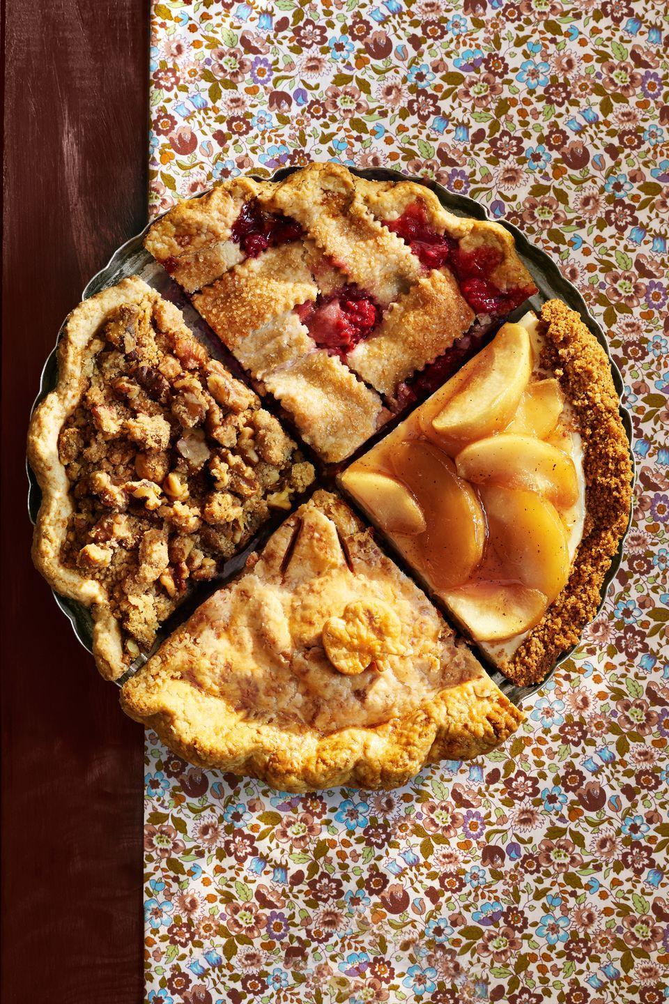 """<p>Satisfy all your guests by serving up a bounty of fall's best flavors all in one pie platter. Or, choose your favorite of these four delicious recipes. </p><p><strong>Recipes: </strong></p><p><strong><a href=""""https://www.countryliving.com/food-drinks/recipes/a36557/ginger-apple-walnut-crumble-pie/"""" rel=""""nofollow noopener"""" target=""""_blank"""" data-ylk=""""slk:Ginger Apple-Walnut Crumble Pie"""" class=""""link rapid-noclick-resp"""">Ginger Apple-Walnut Crumble Pie</a><br></strong></p><p><strong><a href=""""https://www.countryliving.com/food-drinks/recipes/a36582/apple-raspberry-pie/"""" rel=""""nofollow noopener"""" target=""""_blank"""" data-ylk=""""slk:Apple-Raspberry Pie"""" class=""""link rapid-noclick-resp"""">Apple-Raspberry Pie</a><br></strong></p><p><strong><a href=""""https://www.countryliving.com/food-drinks/recipes/a36584/caramelized-apple-cheesecake/"""" rel=""""nofollow noopener"""" target=""""_blank"""" data-ylk=""""slk:Caramelized Apple Cheesecake"""" class=""""link rapid-noclick-resp"""">Caramelized Apple Cheesecake</a><br></strong></p><p><a href=""""https://www.countryliving.com/food-drinks/recipes/a36585/brown-butter-apple-pie-with-cheddar-crust/"""" rel=""""nofollow noopener"""" target=""""_blank"""" data-ylk=""""slk:Brown Butter Apple Pie with Cheddar Crust"""" class=""""link rapid-noclick-resp""""><strong>Brown Butter Apple Pie with Cheddar Crust</strong></a><br></p>"""