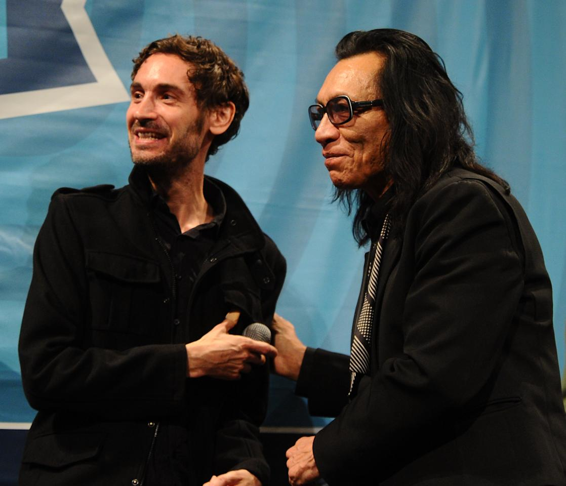 "AUSTIN, TX - MARCH 14:  Director Malik Bendjelloul (L) and musician Rodriguez speak at the ""Searching for Sugar Man"" during the 2012 SXSW Music, Film + Interactive Festival at Paramount Theatre on March 13, 2012 in Austin, Texas.  (Photo by Michael Buckner/Getty Images for SXSW)"