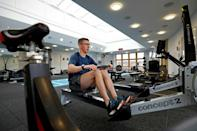 Former flat jockey George Baker exercises in the gym at Oaksey House, in Lambourn, west of London (AFP Photo/ADRIAN DENNIS)