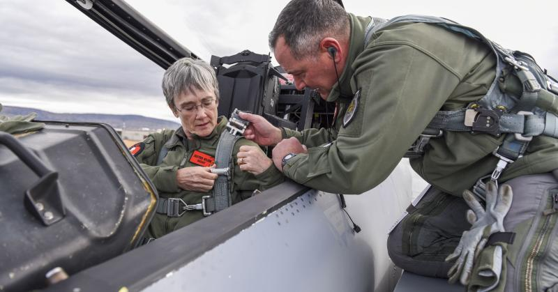 Secretary of the Air Force Heather Wilson straps into an F-15D Eagle before a familiarization flight Nov. 4, 2018.