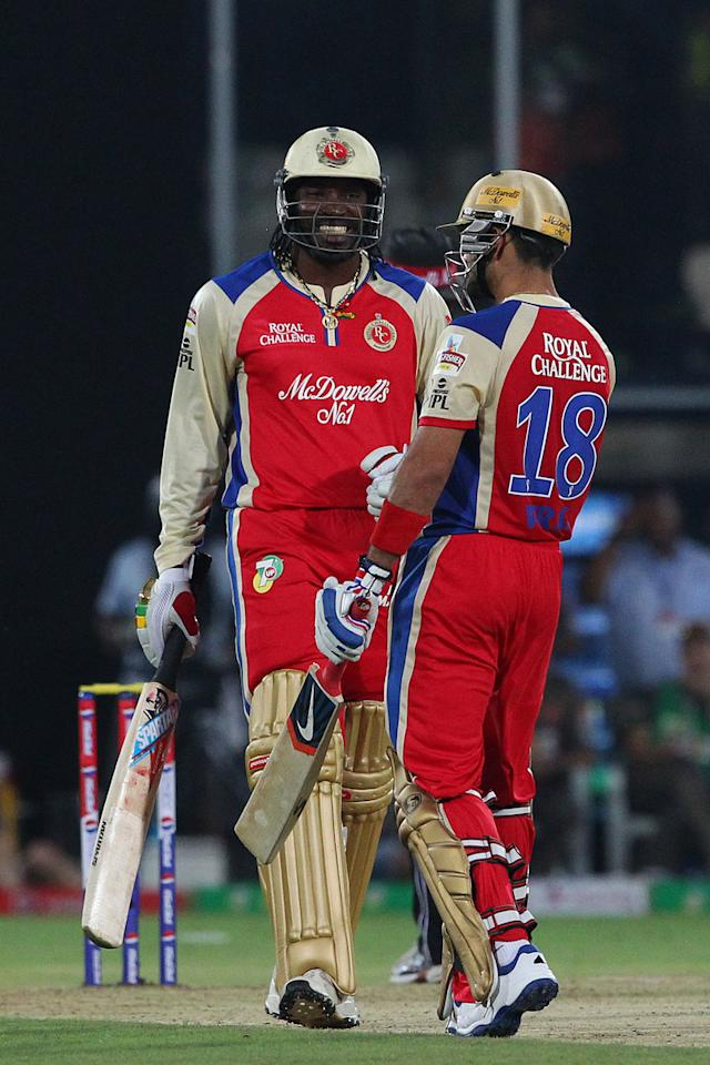 Chris Gayle and Virat Kohli in the Super overduring match 7 of the Pepsi Indian Premier League between The Sunrisers Hyderabad and Royal Challengers Bangalore held at the Rajiv Gandhi International Stadium, Hyderabad on the 7th April 2013..Photo by Ron Gaunt-IPL-SPORTZPICS  ..Use of this image is subject to the terms and conditions as outlined by the BCCI. These terms can be found by following this link:..https://ec.yimg.com/ec?url=http%3a%2f%2fwww.sportzpics.co.za%2fimage%2fI0000SoRagM2cIEc&t=1506333567&sig=M4vltBvS6W_3XCNei_j2XQ--~D