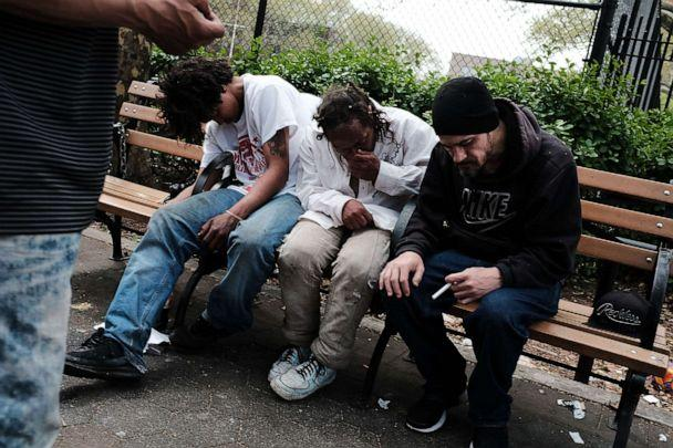 PHOTO: Men sit passed out in a park where heroin users gather to shoot up in the Bronx borough of New York, May 4, 2018. (Spencer Platt/Getty Images, FILE)