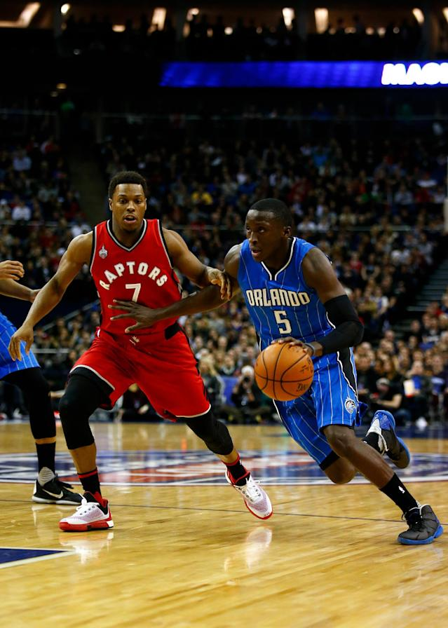 LONDON, ENGLAND - JANUARY 14: Victor Oladipo #5 of the Orlando Magic dribbles past Kyle Lowry #7 of the Toronto Raptors during the 2016 NBA Global Games London match between Toronto Raptors and Orlando Magic at The O2 Arena on January 14, 2016 in London, England. (Photo by Clive Rose/Getty Images)