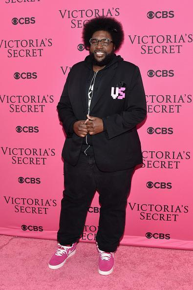 <p>Questione displayed his fandom by wearing hot pink high tops and adding a VS patch to a black blazer. </p>