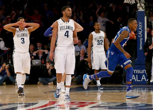 NEW YORK, NY - MARCH 13: Fuquan Edwin #23 of the Seton Hall Pirates celebrates the win as Josh Hart #3,Darrun Hilliard II #4 and James Bell #32 of the Villanova Wildcats react to the loss during the quarterfinals of the Big East Basketball Tournament at Madison Square Garden on March 13, 2014 in New York City.Seton Hall Pirates defeated the Villanova Wildcats 65-63. (Photo by Elsa/Getty Images)