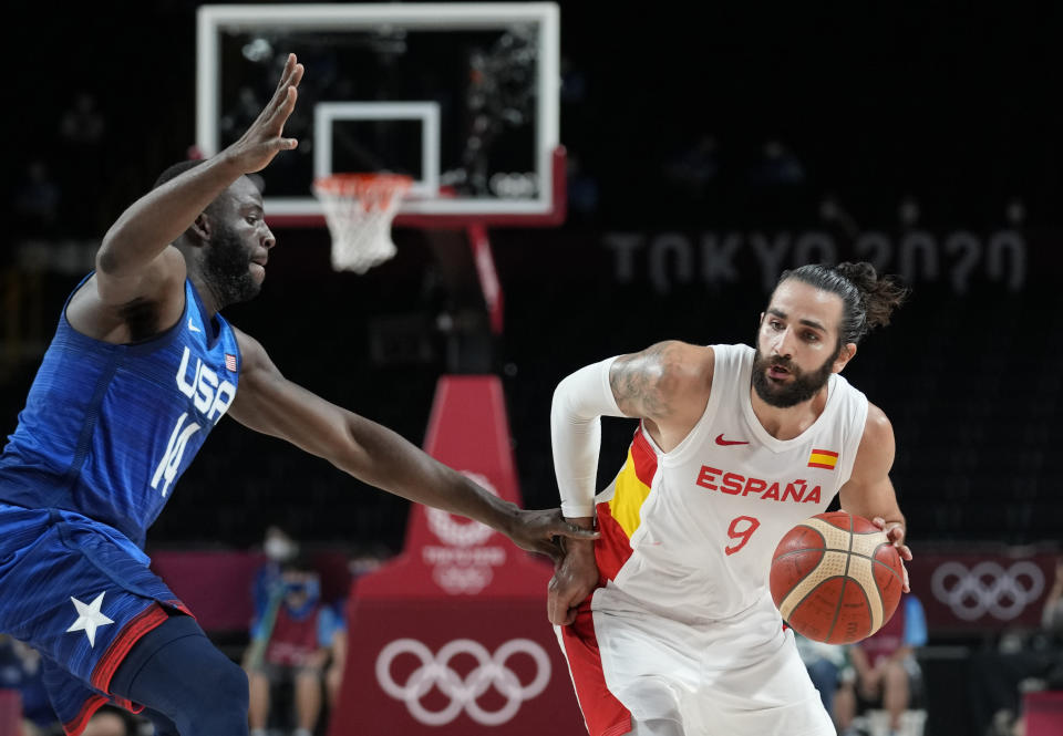 Spain's Ricky Rubio (9), right, drives around United States' Draymond Green (14) during men's basketball quarterfinal game at the 2020 Summer Olympics, Tuesday, Aug. 3, 2021, in Saitama, Japan. (AP Photo/Eric Gay)