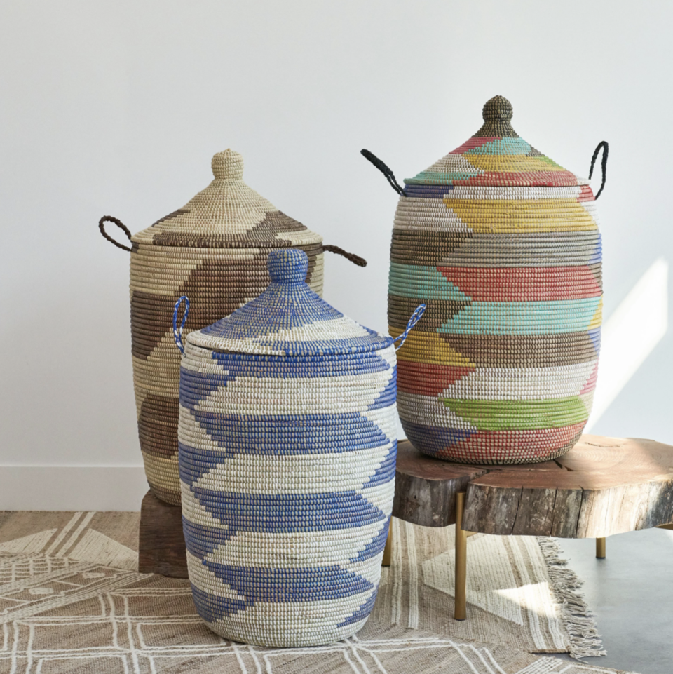 """<p>expeditionsubsahara.com</p><p><strong>$185.00</strong></p><p><a href=""""https://expeditionsubsahara.com/collections/woven-african-storage-baskets-and-hampers/products/large-african-storage-basket-with-lid?variant=31158784196688"""" rel=""""nofollow noopener"""" target=""""_blank"""" data-ylk=""""slk:Shop Now"""" class=""""link rapid-noclick-resp"""">Shop Now</a></p><p>These handmade baskets from sweetgrass use a traditional coil-style weaving technique from Senegal and <a href=""""https://www.housebeautiful.com/design-inspiration/a34289050/expedition-subsahara-african-baskets/"""" rel=""""nofollow noopener"""" target=""""_blank"""" data-ylk=""""slk:can take 40 hours to craft."""" class=""""link rapid-noclick-resp"""">can take 40 hours to craft.</a> They also use recycled materials to color the baskets. Perfect for any kind of storage, the colors of these baskets will lift the mood in any space!<br></p>"""