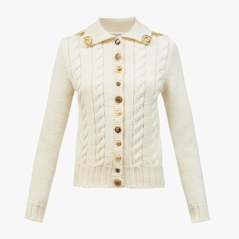 """$1550, MATCHES FASHION. <a href=""""https://www.matchesfashion.com/us/products/Loewe-Anagram-button-cable-knit-wool-cardigan-1378622"""" rel=""""nofollow noopener"""" target=""""_blank"""" data-ylk=""""slk:Get it now!"""" class=""""link rapid-noclick-resp"""">Get it now!</a>"""