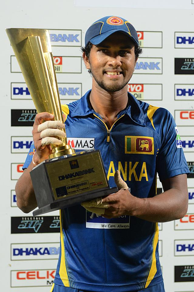 Sri Lankan Twenty20 cricket captain Dinesh Chandimal poses with the trophy the after their victory during the Twenty20 International match against Bangladesh at The Pallekele International Cricket Stadium in Pallekele on March 31, 2013. AFP PHOTO/ Ishara S. KODIKARA