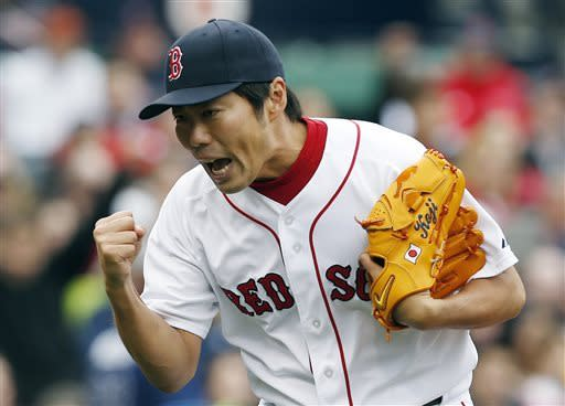 Boston Red Sox pitcher Koji Uehara reacts after Tampa Bay Rays' Ryan Roberts pop out to end the top of the ninth inning with two men left on base during a baseball game in Boston, Saturday, April 13, 2013. (AP Photo/Michael Dwyer)