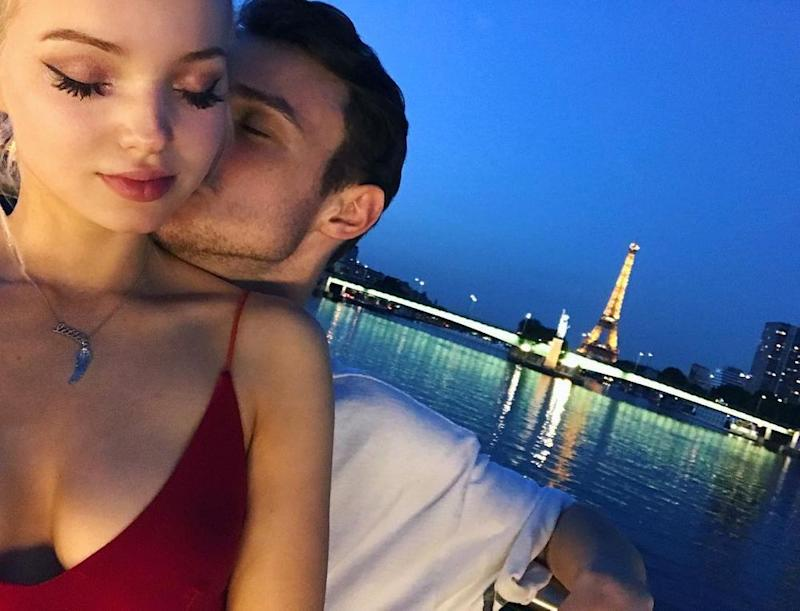 Dove Cameron and Thomas Doherty on a boat in Paris
