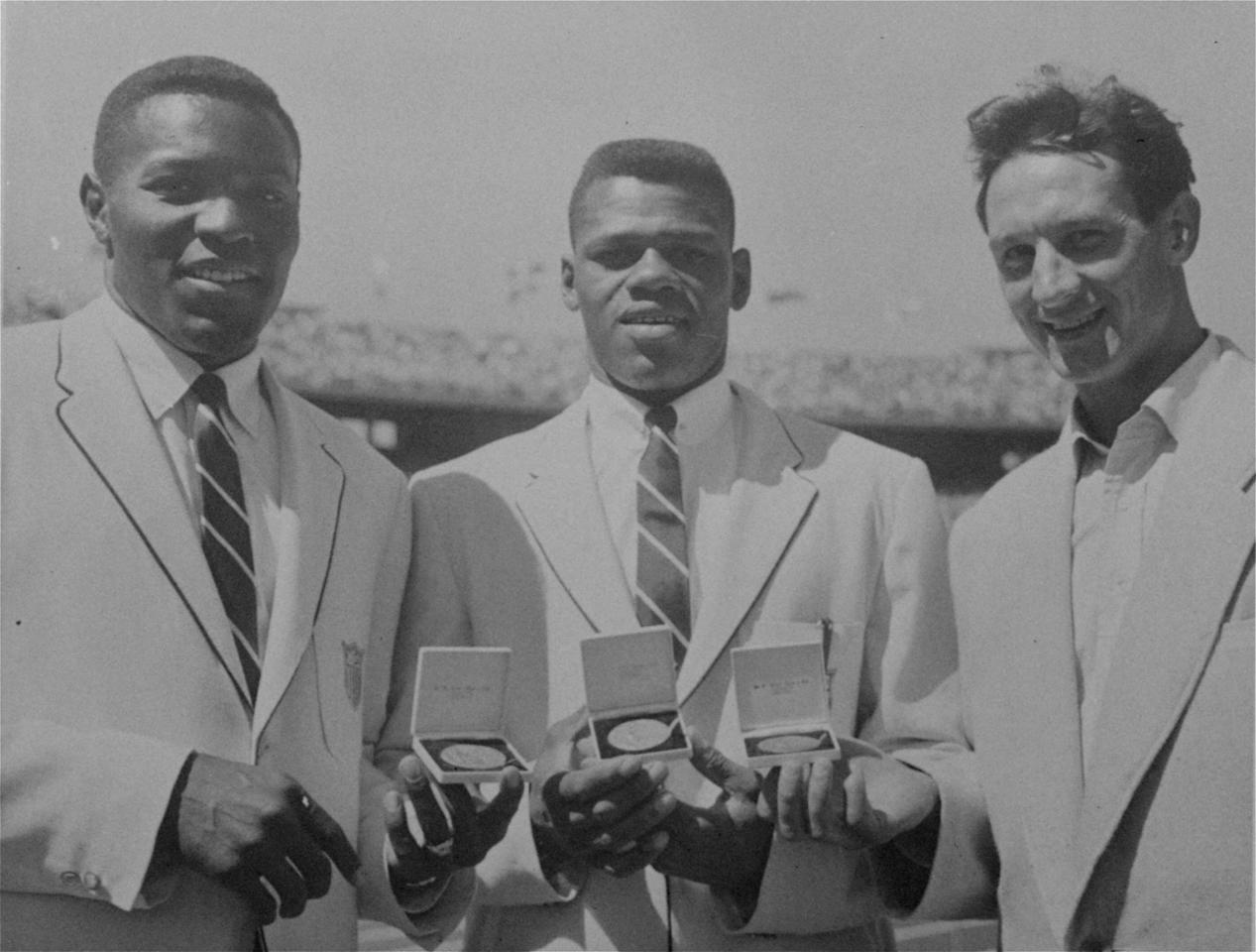 Olympic Decathlon victors with their medals after the presentation at the main stadium in Melbourne, November 30, 1956.  They are Americans Milton Campbell, center; and Rafer Johnson, left; and Russia's Vassily Kouznetsov. (AP Photo)