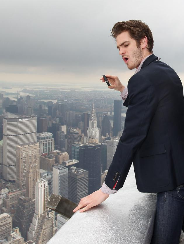 Celebrity photos: During his promotional trail for the new Spiderman movie, Andrew Garfield made a trip to the top of the Empire State building. He was so overwhelmed by the view that he whipped out his iPhone and started taking pictures. Copyright [Rex]